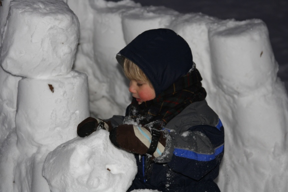 My almost four year helps build a snow fort at Christmas - his first.