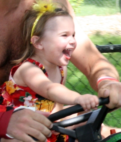 Lil Diva loved driving the mower at top speed.